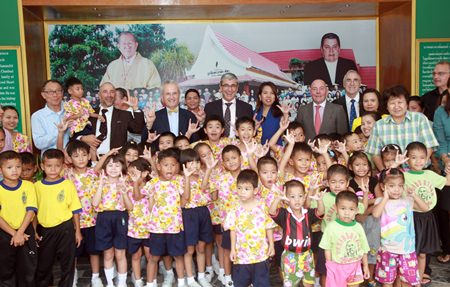 French Ambassador H.E. Thierry Viteau and his aides pose for a fun group photo with children and administrators of the Pattaya Orphanage.