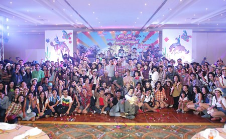 Employees and Dusit Thani administrators pose for a picture during the staff party.