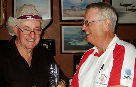 Dick Warberg (right) presents the MBMG Group Golfer of the Month award to Barry Oats.