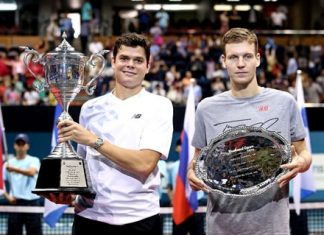 Milos Raonic (left) hoists the champion's trophy after defeating Tomas Berdych (right) in the final of the Thailand Open 2013 in Bangkok, Sunday, Sept. 29.