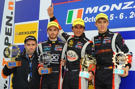 Sandy Stuvik (2nd right) celebrates on the podium after winning Race 2 at the Monza Circuit in Italy.