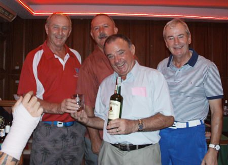 Sunday's winners, Jim, Kevin and Tom with golf manager Colin.