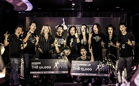 Jakkrapan Kanchoungchote (front center left) poses with the judges and fellow contestants on stage at the conclusion of the Hard Rock Pattaya Guitar Battle, Nov. 16.