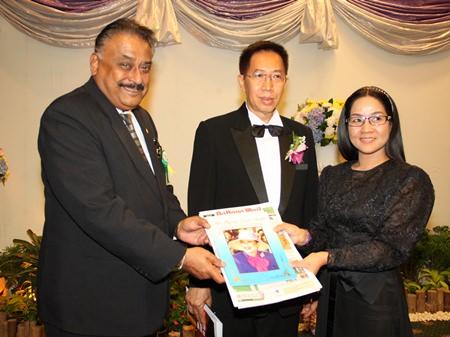 Peter Malhotra (left) and Suthasinee Maneekul (right) present commemorative books to Chao Pakinai Na Chiang Mai.