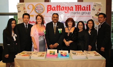 The Pattaya Mail Media Group team stands at our booth awaiting the arrival of the princess. Nopniwat Krailerg (2nd left), Shana Kongmun, Peter Malhotra, Elfi Seitz, Suthasinee Maneekul and Peerasan Wongsri (right) GM Chiang Mai Mail.