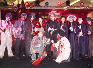 Somporn Naksuetrong (center), vice president of the Royal Garden Plaza, brings out the ghosts, ghouls and goblins to begin the Halloween Fancy Costume Contest.
