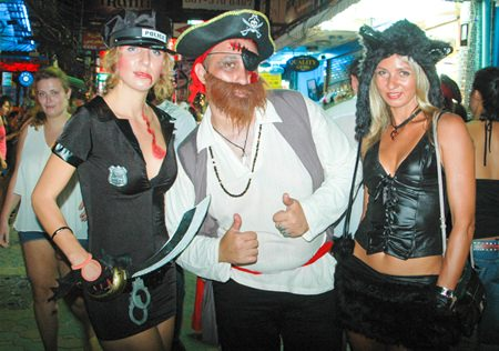 Aye matey, 'twas a good night for scaring people.  This pirate and his two sexy companions blended quite well into the Halloween scene on Walking Street.