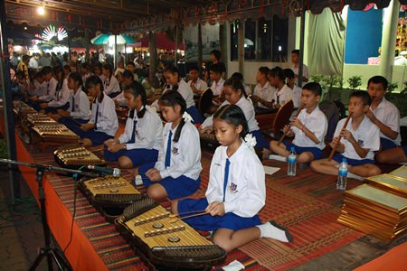 Students play traditional instruments for their Sattahip performance.