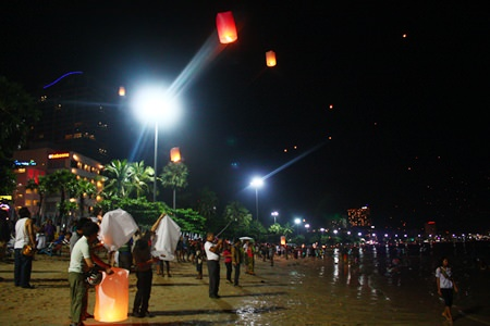 The night sky is filled with dots of light coming from the thousands of khomloys launched from Pattaya Beach.
