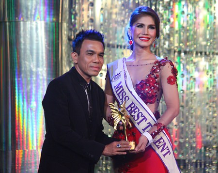 Nur Sajat Fariz (right), contestant no. 7 from Malaysia, accepts the Best Talent award.