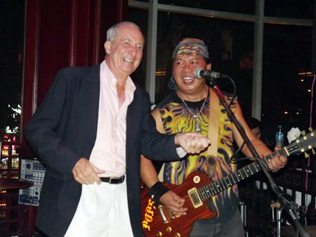Pop wails on the real guitar whilst Dr Iain flails away on the air guitar.