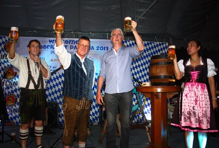 "Their beer krugs charged to the brim, Brendan, Ken and Panpicha cry ""Prost""."