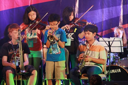 Young stars play trumpets and violins during the FOBISSEA Music Festival.