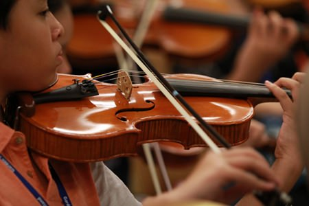 A budding violinist plays during the festival.