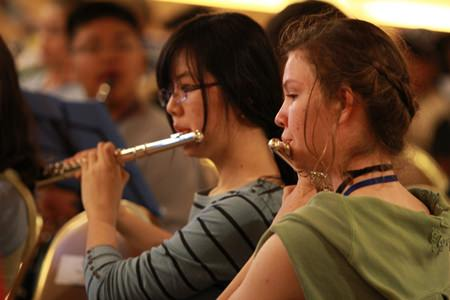 Two of GIS's talented musicians play the flute during rehearsals.