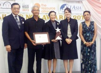 The Human Help Network Foundation accepts their award for earning 3rd Runner-Up for Thailand at the 2013 NGO Awards.