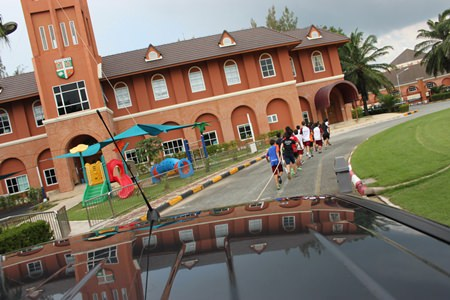 The school's record breaking 'Truck Pull' attempt cruising passed Regent's Early years building