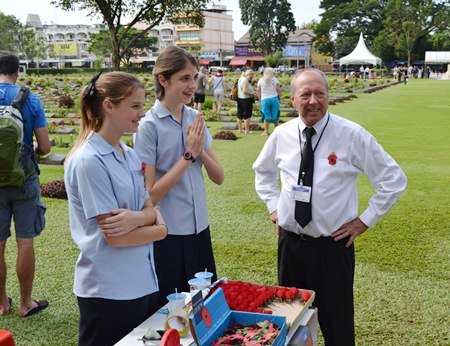 Generous GIS students help sell poppies in Kanchanaburi.
