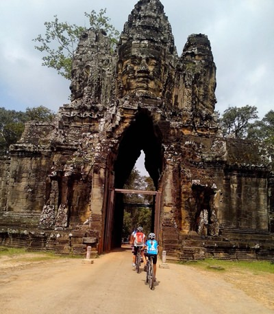 Poppy and her support team peddling through the gates to Angkor Wat.