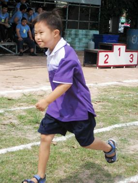 A runner in action, smiling all the way to the finish line.