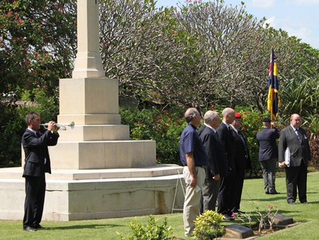 Instrumental Teacher Clarence Mansell plays at the Remembrance Day Service at Don Rak War Cemetery in Kanchanaburi.
