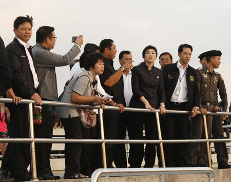 The look of concern shows on Prime Minister Yingluck Shinawatra (Front row 3rd right) as officials explain what happened when an overcrowded ferry operated by Koh Larn Travel and being captained by a man who confessed to being high on methamphetamines capsized, killing six tourists; 3 Thais, 2 Polish and 1 Hong Kong Chinese.