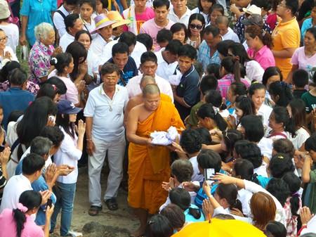Baideeka Kittisak Attakovito, abbot at Dokkrai Temple, collects precious items to put into the Buddha statue.