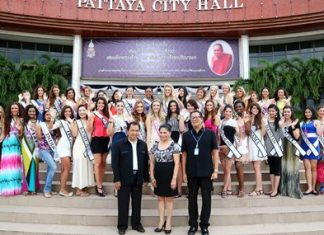 (Front row, left to right) Choosak Sriwatjanapong, City Council District 4 member, Mila Manuel, CEO and Founder of Face of Beauty International Ltd. and Pattaya Mayoral Secretary Phumipipat Kamolnat pose with the beauty contestants in front of Pattaya City Hall.