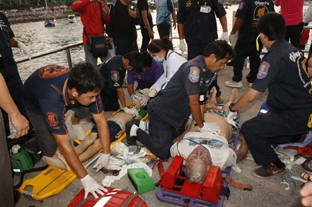 Emergency Medical Technicians frantically provide CPR to try and save the victims.