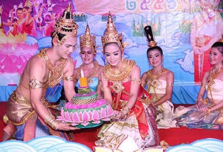 A young couple loys their krathong (sets their float adrift) during the city's announcement for this year's holiday.