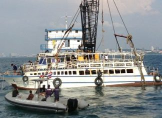 Pattaya salvage teams use slings to raise the Koh Larn Travel ferry that sunk Nov. 3, killing seven and injuring scores more.