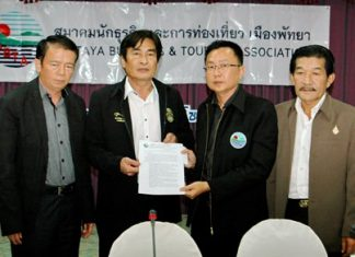 (L to R) Banglamung District Chief Sakchai Taengho and Deputy Mayor Ronakit Ekasingh, representing the government sector, accept the unsealed documents from PBTA President Sinchai Wattanasartsathorn and PBTA consultant Sa-nga Kitsamret, representing the private sector, which is insisting the government implement effective safety measures.