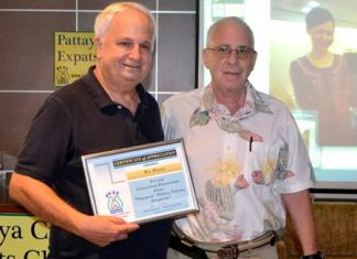 MC Richard Silverberg presents Rey with a Certificate of Appreciation as thanks for his insightful presentation.