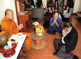 Xanxai Visitkul followed by Peter Malhotra and staff chant prayers during the religious ceremonies.