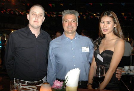 (L to R) Samuel D Kennedy, Executive Director of Emerging Markets Energy, Mark Parkins, Operations Manager for McConnell Dowell Constructors Thai Ltd., and Kantiya Boonruang.