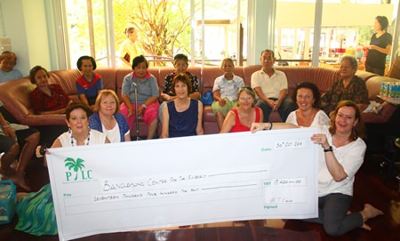 The PILC formerly present a cheque valued at 17,400 Thai Baht to the Banglamung Home for the Elderly for assistance in purchasing two washing machines.