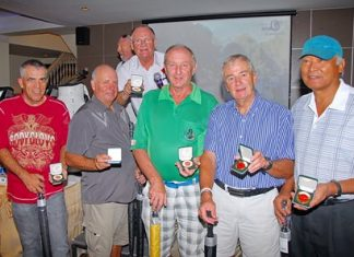Near pin winners show off their Poppy Golf medals.
