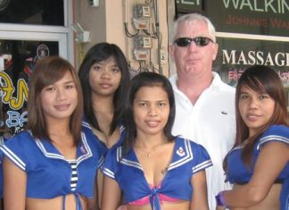 Irish John (2nd right) celebrates his win with the girls at Blue Sky Bar.