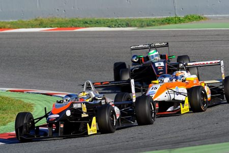 Stuvuk leads a group of three cars through a corner during the European Formula 3 Open Championship season ending race weekend in Barcelona.