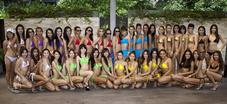 The teams line up for a group photo at Areca Lodge in Pattaya, Saturday, Oct. 26.