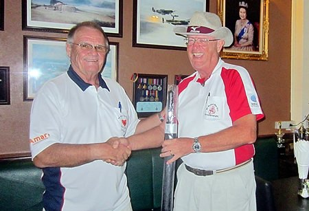 Derek Brook (left) presents the MBMG Group golfer of the month prize to Dick Warberg.