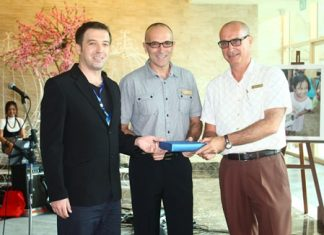 (L to R) Baki Colpam, reservation and contracting manager of Pegas, presents a souvenir to Robert John Lohrmann, general manager, and George Kenton, EAM-rooms of Centara Grand Mirage Beach Resort Pattaya as the favorite hotel chain of its Russian and Eastern European clientele.