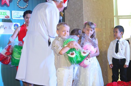 Children hug their dolls tight after singing Christmas carols at BHP.