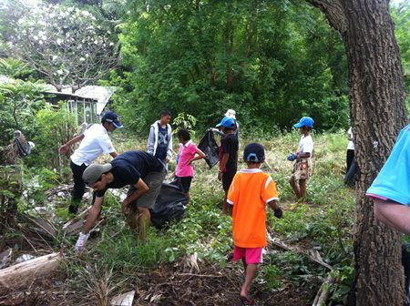 Children from Human Help Network Foundation cleaning up outside Cosy Beach Hotel.