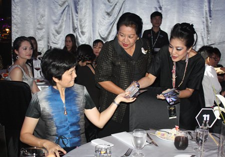 Thanpuying Busyarat Permsub (center) and employees of Hard Rock Hotel Pattaya sell raffle tickets to raise finds for charity.