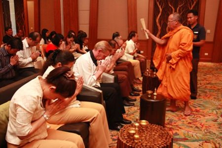 GM Robert John Lohrmann led the management team and staff through a monk ceremony commemorating the hotel's 4th anniversary.