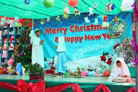 Children perform the Nativity.