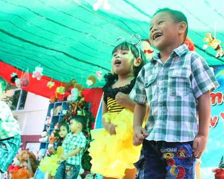 3&4 year old children perform dances for the audience.