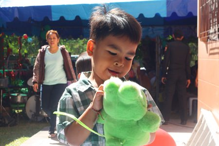 This little one received a stuffed animal as a reward for his stage performance.