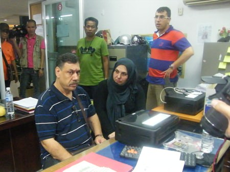 (Seated) Isa Atsan and Melaken Parsa have been arrested for grifting their countryman out of US$800.